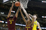 Minnesota's Jordan Murphy (3), Dupree McBrayer (1) and Michigan's Colin Castleton battle for a rebound during the first half of an NCAA college basketball game in the semifinals of the Big Ten Conference tournament, Saturday, March 16, 2019, in Chicago. (AP Photo/Kiichiro Sato)