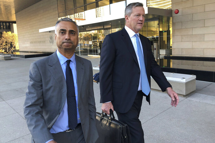 In this Nov. 22, 2019 file photo, Imaad Zuberi, left, leaves the federal courthouse with his attorney Thomas O'Brien, right, in Los Angeles. Federal prosecutors on Tuesday, Jan. 7, 2020, charged Zuberi, a major donor to President Donald Trump's Inaugural Committee, with obstructing a federal investigation into whether foreign nationals unlawfully contributed to the inaugural celebrations. (AP Photo/Brian Melley, File)