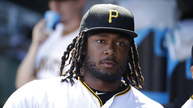 FILE - In this  Saturday, June 22, 2019 file photo, Pittsburgh Pirates' Josh Bell waits to take the field for the team's baseball game against the San Diego Padres in Pittsburgh. Pirates first baseman Josh Bell watched George Floyd's death in horror. Rarely one to talk, Bell prefers to have his actions speak for him. Bell, who is Black, has started a book club and a weekly