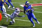 Los Angeles Rams' Darrell Henderson (27) rushes past Buffalo Bills' Dean Marlowe (31) during the first half of an NFL football game Sunday, Sept. 27, 2020, in Orchard Park, N.Y. (AP Photo/Adrian Kraus)