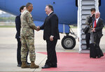U.S. Secretary of State Mike Pompeo, center,  shakes hands with U.S. General Vincent K. Brooks, commander of United States Forces Korea, upon his arrival at Osan Air Base in Pyeongtaek Wednesday, June 13, 2018.  South Korea's presidential office said Pompeo will meet President Moon Jae-in Thursday morning to discuss the meeting, which made history as the first between sitting leaders of the U.S. and North Korea. (Jung Yeon-je/Pool Photo via AP)