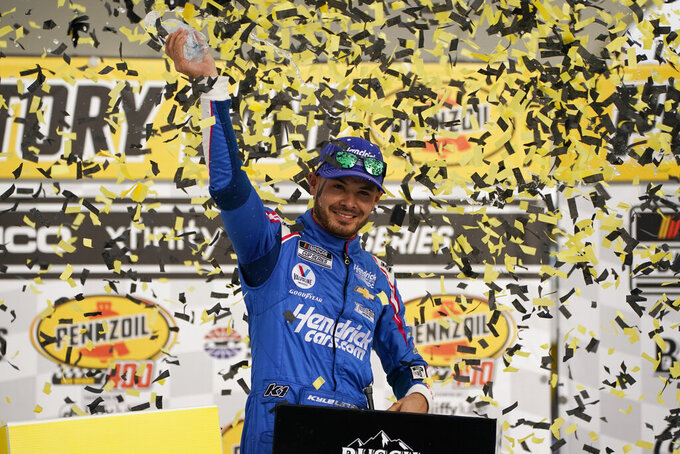 Kyle Larson celebrates after winning a NASCAR Cup Series auto race Sunday, March 7, 2021, in Las Vegas. (AP Photo/John Locher)