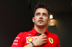 Ferrari driver Charles Leclerc, of Monaco, stands in the paddock, at the Monza racetrack, in Monza, Italy, Thursday, Sept. 5, 2019. The Formula one GP will be held on Sunday. (AP Photo/Antonio Calanni)