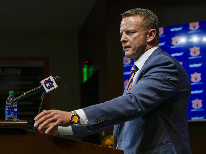 FILE - In this photo provided by Auburn Athletics, Bryan Harsin, Auburn's new college football coach, talks during a news conference in Auburn, Ala., in this Thursday, Dec. 24, 2020, photo. It's been a whirlwind three weeks for Auburn's football team, given longtime coach Gus Malzahn getting fired on Dec. 13, new coach Bryan Harsin being introduced 11 days later, several players opting out of the Citrus Bowl and the Tigers hurriedly trying to prepare for a showdown against a stout Northwestern defense. (Todd Van Emst/Auburn Athletics via AP)