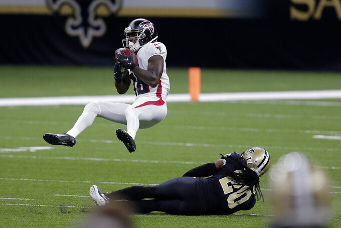 Atlanta Falcons wide receiver Calvin Ridley (18) pulls in a pass over New Orleans Saints cornerback Janoris Jenkins (20) in the first half of an NFL football game in New Orleans, Sunday, Nov. 22, 2020. (AP Photo/Brett Duke)