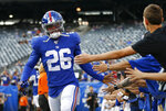 FILE - In this Aug. 16, 2019, file photo, New York Giants running back Saquon Barkley (26) greets fans before an NFL football game against the Chicago Bears in East Rutherford, N.J. Barkley set team rookie records for yards rushing (1,307) receptions (91) and total touchdowns (15) playing behind a bad line. With trade acquisition Kevin Zeitler at right guard, free agent Mike Remmers at right tackle and C Jon Halapio back from from a major leg injury, this could be an even bigger year for the NFL Offensive Rookie of the Year and the league leader in yards from scrimmage (2,028). (AP Photo/Adam Hunger, File)