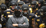 Appalachian State coach Shawn Clark stands with his team prior to an NCAA college football game against Charlotte on Saturday, Sept. 12, 2020, in Boone, N.C. (Allison Lee Isley/The Winston-Salem Journal via AP)