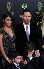 Barcelona's Lionel Messi poses with his family during the Golden Ball award ceremony at the Grand Palais in Paris, Monday, Dec. 2, 2019. Awarded every year by France Football magazine since Stanley Matthews won it in 1956, the Ballon d'Or, Golden Ball for the best player of the year will be given to both a woman and a man. (AP Photo/Francois Mori)