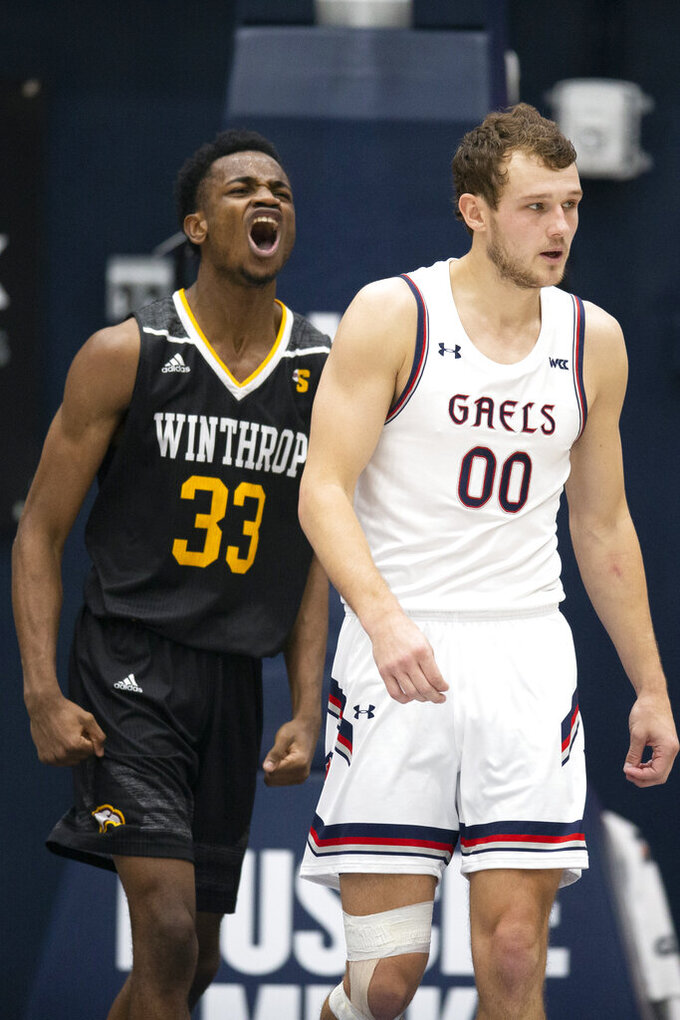 Winthrop forward Chase Claxton (33) reacts to a foul call against Saint Mary's guard Tanner Krebs (00) during the second half of an NCAA college basketball game, Monday, Nov. 11, 2019 in Moraga, Calif. Winthrop upset 18th-ranked Saint Mary's 61-59. (AP Photo/D. Ross Cameron)