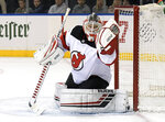 New Jersey Devils goaltender Cory Schneider gloves the puck during the second period of the team's NHL hockey game against the New York Rangers on Saturday, March 9, 2019, at Madison Square Garden in New York. (AP Photo/ Bill Kostroun)