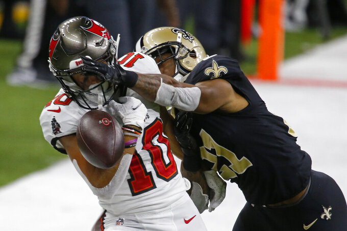 New Orleans Saints cornerback Patrick Robinson (21) defends a pass against Tampa Bay Buccaneers wide receiver Scott Miller (10) in the second half of an NFL football game in New Orleans, Sunday, Sept. 13, 2020. (AP Photo/Butch Dill)