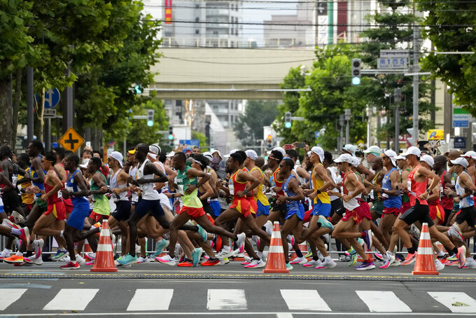 Runners compete during the men's marathon at the 2020 Summer Olympics, Sunday, Aug. 8, 2021, in Sapporo, Japan. (AP Photo/Eugene Hoshiko)