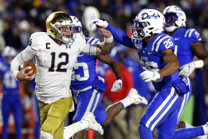 Book throws 4 TDs, No. 15 Notre Dame routs Duke 38-7