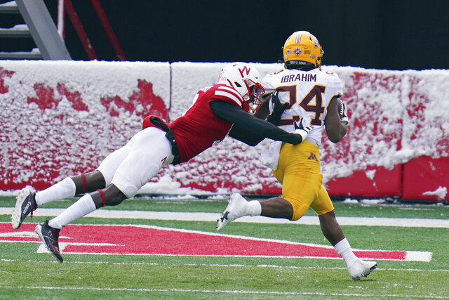 Minnesota running back Mohamed Ibrahim (24) scores a touchdown in front of Nebraska safety Marquel Dismuke (9) during the first half of an NCAA college football game in Lincoln, Neb., Saturday, Dec. 12, 2020. (AP Photo/Nati Harnik)