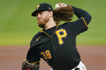 Pittsburgh Pirates starting pitcher Dillon Peters delivers during the first inning of the team's baseball game against the Detroit Tigers in Pittsburgh, Tuesday, Sept. 7, 2021. (AP Photo/Gene J. Puskar)