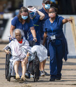 Paramedics evacuate people at a mass shelter Thursday, Sep.t 2, 2021 in Independence, La. Multiple nursing home residents died after Hurricane Ida, but full details of their deaths are unknown because state health inspectors said Thursday that they were turned away from examining conditions at the facility to which they had been evacuated. (Chris Granger/The Times-Picayune/The New Orleans Advocate via AP)