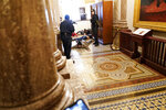 U.S. Capitol Police hold rioters at gun-point near the House Chamber inside the U.S. Capitol on Wednesday, Jan. 6, 2021, in Washington. (AP Photo/Andrew Harnik)