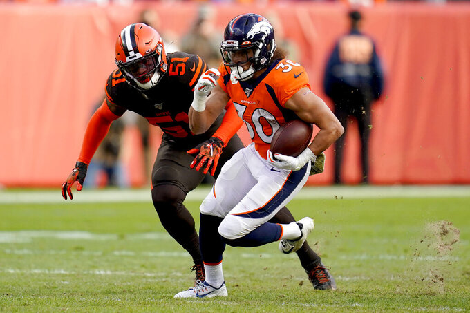 Denver Broncos running back Phillip Lindsay (30) runs as Cleveland Browns linebacker Mack Wilson (51) pursues during the first half of NFL football game, Sunday, Nov. 3, 2019, in Denver. (AP Photo/Jack Dempsey)
