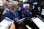 Specialist James Denaro, right, calls out prices to traders at his post on the floor of the New York Stock Exchange, Monday, Nov. 4, 2019. Stocks are opening higher on Wall Street, pushing major indexes toward more record highs. (AP Photo/Richard Drew)