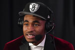 Cameron Thomas answers questions during an interview after being selected 27th overall by the Brooklyn Nets during the NBA basketball draft, Thursday, July 29, 2021, in New York. (AP Photo/Corey Sipkin)