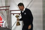 Team Europe captain Padraig Harrington carries in the trophy at a new conference for the Ryder Cup at the Whistling Straits Golf Course Monday, Sept. 20, 2021, in Sheboygan, Wis. (AP Photo/Morry Gash)