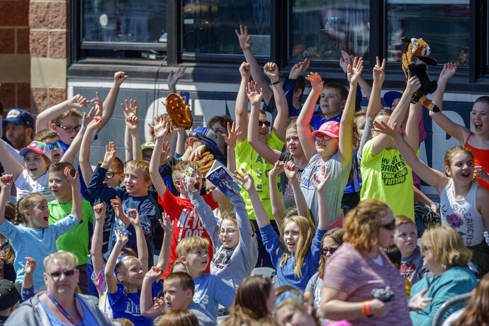 FILE - In this April 11, 2018, file photo, school children cheer as the West Virginia Power face the Lakewood BlueClaws at Appalachian Power Park, in Charleston, W.V. Major League Baseball is pushing a proposal to whack 42 teams _ and several entire leagues _ from its vast network of minor-league affiliates that bring the game to every corner of country. Take the South Atlantic League, a Class A organization that has 14 teams stretching from New Jersey to Georgia. Under the contraction plan, three of its teams _ the Hagerstown Suns, Lexington Legends, West Virginia Power _ would be eliminated.  (Craig Hudson/Charleston Gazette-Mail via AP, File)