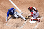 Kansas City Royals' Alex Gordon, left, is out at the plate against Washington Nationals catcher Yan Gomes, right, during the fourth inning of a baseball game, Sunday, July 7, 2019, in Washington. (AP Photo/Nick Wass)