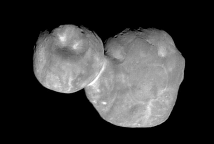 FILE- This Tuesday, Jan. 1, 2019, file image made available by NASA shows the Kuiper belt object Ultima Thule, about 1 billion miles beyond Pluto, encountered by the New Horizons spacecraft. New photos from the New Horizons spacecraft offer a new perspective on the small cosmic body 4 billion miles (6.4 billion kilometers) away. Scientists say the object is actually flatter on the backside than originally thought. (NASA/Johns Hopkins University Applied Physics Laboratory/Southwest Research Institute via AP, File)