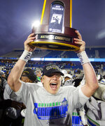 West Florida quarterback Austin Reed celebrates after winning the Division II championship NCAA college football game against Minnesota State, Saturday, Dec. 21, 2019, in McKinney, Texas. (AP Photo/Gareth Patterson)
