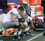 Colorado offensive lineman Jack Shutack, left, sits on the bench late in the second half of an NCAA college football game against Washington, Saturday, Oct. 20, 2018, in Seattle. Washington won 27-13. (AP Photo/Ted S. Warren)
