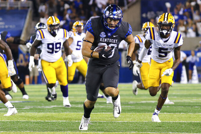Kentucky tight end Justin Rigg (83) carries the ball during the first half of the team's NCAA college football game against LSU in Lexington, Ky., Saturday, Oct. 9, 2021. (AP Photo/Michael Clubb)