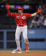 Cincinnati Reds' Curt Casali celebrates hitting a double during the ninth inning of a baseball game against the Los Angeles Dodgers, Monday, April 15, 2019, in Los Angeles. (AP Photo/Mark J. Terrill)