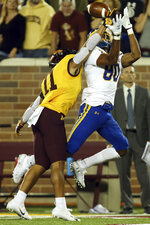 Minnesota defensive back Antoine Winfield Jr. (11) blocks the ball to South Dakota State wide receiver Adam Anderson (80) during an NCAA college football game Thursday, Aug. 29, 2019, in Minneapolis. (AP Photo/Stacy Bengs)
