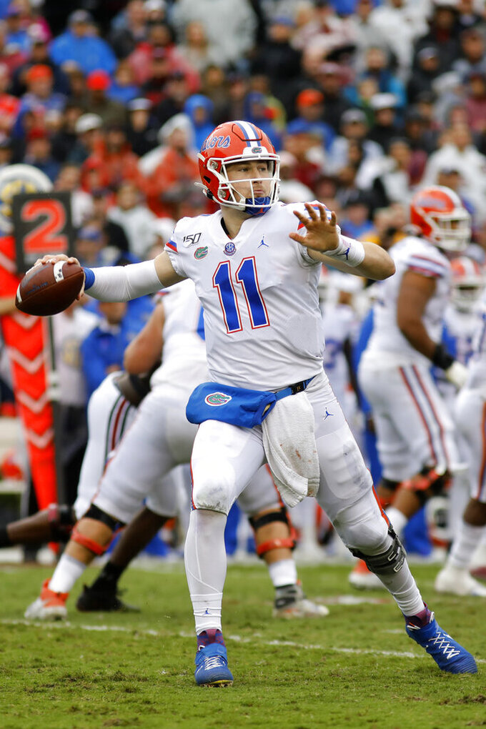 Florida's Kyle Trask throws a pass against South Carolina in the second half of an NCAA college football game Saturday, Oct. 19, 2019, in Columbia, SC. Florida defeated South Carolina 38-27. (AP Photo/Mic Smith)
