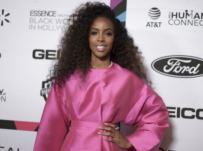 """FILE - This Feb. 21, 2019 file photo shows Kelly Rowland at the 12th Annual ESSENCE Black Women in Hollywood Awards in Beverly Hills, Calif. Rowland released an EP titled """"K,"""" featuring six tracks heavily influenced by Afrobeat rhythms. (Photo by Richard Shotwell/Invision/AP, File)"""