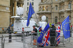 Anti-Brexit protestors hold British and European flags as they demonstrate outside the London TV studios prior to a Live TV debate by Conservative Party candidates in London, Tuesday, June 18, 2019.  Britain's Conservative Party will continue to hold elimination votes until the final two contenders will be put to a vote of party members nationwide, with the winner due to replace Prime Minister Theresa May as party leader and prime minister. (AP Photo/Vudi Xhymshiti)
