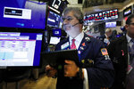 Trader John Panin works on the floor of the New York Stock Exchange, Tuesday, Oct. 8, 2019. Stocks are opening lower on Wall Street as tensions rose between Washington and Beijing just ahead of the latest round of trade talks. (AP Photo/Richard Drew)
