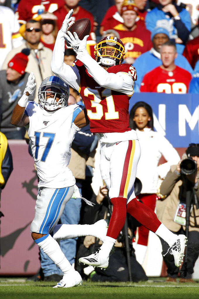 Washington Redskins cornerback Fabian Moreau (31) intercepts a pass from Detroit Lions quarterback Jeff Driskel, not visible, intended for wide receiver Marvin Hall (17) during the first half of an NFL football game, Sunday, Nov. 24, 2019, in Landover, Md. (AP Photo/Patrick Semansky)