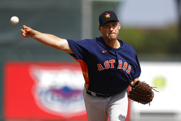 FILE- In this March 3, 2020, file photo, Houston Astros pitcher Jared Hughes throws to a St. Louis Cardinals batter during the third inning of a spring training baseball game in Jupiter, Fla. The sinkerballing reliever and the Mets agreed Tuesday, June 30, 2020, to a $700,000, one-year contract, a deal that amounts to $259,259 in prorated pay over the 60-game season. (AP Photo/Julio Cortez, File)