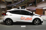 FILE - In this Jan. 16, 2019, file photo, Cruise AV, General Motor's autonomous electric Bolt EV is displayed in Detroit. General Motors' self-driving car company is sending vehicles without anybody behind the wheel in San Francisco as it navigates its way toward launching a robotic taxi service that would compete against Uber and Lyft in the hometown of the leading ride-hailing services. The move announced Wednesday, Dec. 9, 2020, by GM-owned Cruise come two months after the company received California's permission to fully driverless cars in the state.  (AP Photo/Paul Sancya, File)