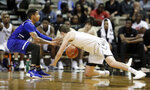 UNC Asheville guard Cress Worthy, left, and Vanderbilt forward Matt Ryan fight for the ball in the second half of an NCAA college basketball game Monday, Dec. 31, 2018, in Nashville, Tenn. (AP Photo/Mark Humphrey)