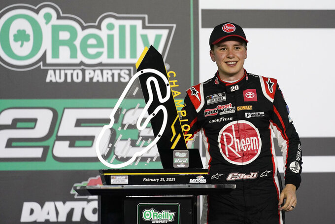 Christopher Bell celebrates in Victory Lane after winning the NASCAR Cup Series road course auto race at Daytona International Speedway, Sunday, Feb. 21, 2021, in Daytona Beach, Fla. (AP Photo/John Raoux)