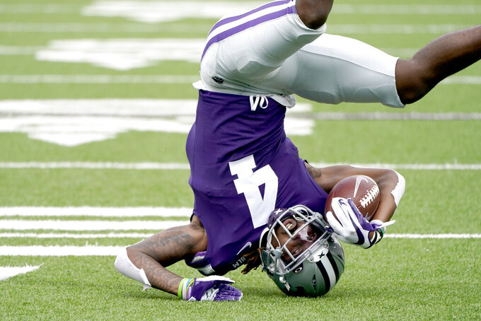 Kansas State wide receiver Malik Knowles catches a pass during the first half of an NCAA college football game against Arkansas State Saturday, Sept. 12, 2020, in Manhattan, Kan. (AP Photo/Charlie Riedel)