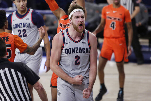 Gonzaga forward Drew Timme celebrates after scoring a basket during the first half of the team's NCAA college basketball game against Pacific in Spokane, Wash., Saturday, Jan. 23, 2021. (AP Photo/Young Kwak)