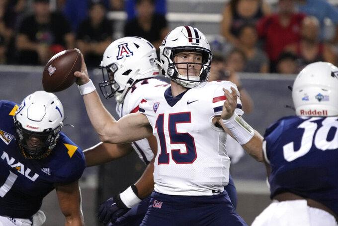 Arizona quarterback Will Plummer throws down field against Northern Arizona during the first half of an NCAA college football game, Saturday, Sept. 18, 2021, in Tucson, Ariz. (AP Photo/Rick Scuteri)