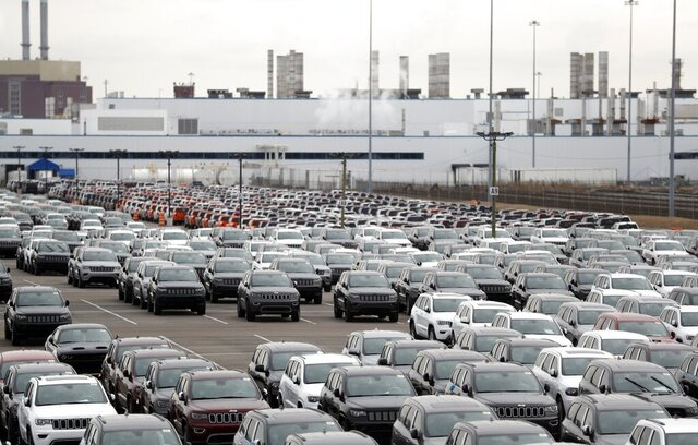 FILE - In this Feb. 26, 2019 file photo, Jeep vehicles are parked outside the Jefferson North Assembly Plant in Detroit.   Major U.S. automakers are planning to reopen North American factories within two weeks, potentially putting thousands of workers back on the assembly line, as part of a gradual return to normality.  Fiat Chrysler CEO Mike Manley said Tuesday, May 5, 2020,  his company plans to start reopening factories May 18 depending on easing of government restrictions.  (AP Photo/Carlos Osorio, File)