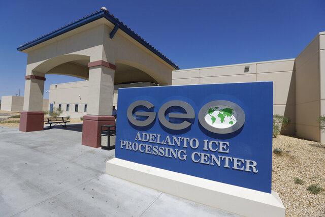 FILE - In this Aug. 28, 2019, file photo, the Adelanto U.S. Immigration and Enforcement Processing Center operated by GEO Group, Inc. (GEO), a Florida-based company specializing in privatized corrections, is viewed in Adelanto, Calif. The Trump administration has awarded four contracts worth billions of dollars to operate private immigration detention centers in California, less than two weeks before a new state law forbidding them takes effect. (AP Photo/Chris Carlson, File)