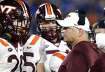 FILE - In this Sept. 29, 2018, file photo, Virginia Tech coach Justin Fuente speaks with his players during the first half of an NCAA college football game against Duke in Durham, N.C. Fuente's Hokies can improve to 3-0 on the road in the Atlantic Coast Conference when they visit North Carolina on Saturday. (AP Photo/Gerry Broome, File)