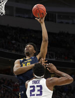 UC Irvine forward Elston Jones, top, shoots over Kansas State forward Austin Trice (23) during the second half of a first-round game in the NCAA men's college basketball tournament Friday, March 22, 2019, in San Jose, Calif. (AP Photo/Chris Carlson)