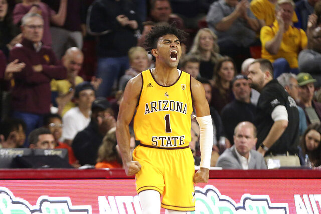 FILE - In this Feb. 22, 2020, file photo, Arizona State's Remy Martin (1) shows his feelings after a run by his Sun Devils against Oregon State during the second half of an NCAA college basketball game in Tempe, Ariz. Martin was selected to the Associated Press All Pac-12 team selected Tuesday, March 10, 2020. (AP Photo/Darryl Webb, File)
